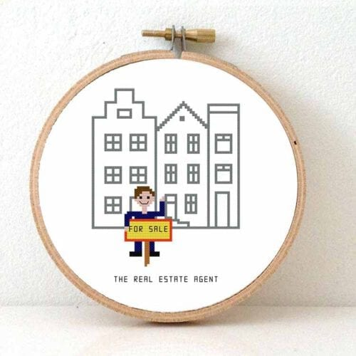 14011 male real estate agent cross stitch kit
