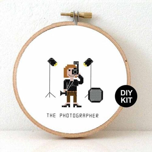 female photographer cross stitch kit
