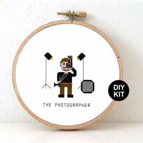 male photographer cross stitch kit