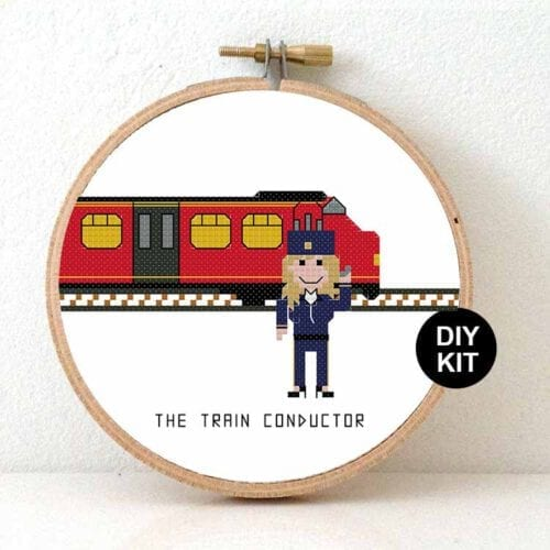 female train conductor cross stitch kit