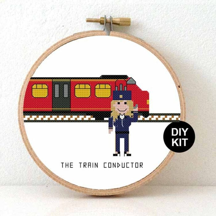 female train conductor cross stitch kit
