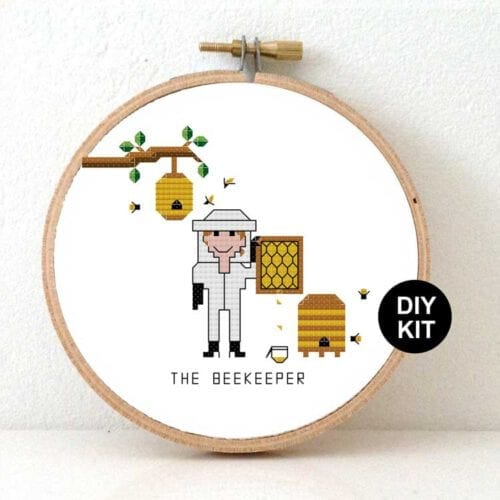 female beekeeper cross stitch kit