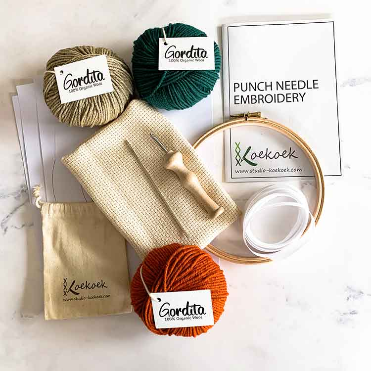 punch needle supplies kit with instructions and green and orange ecological wool