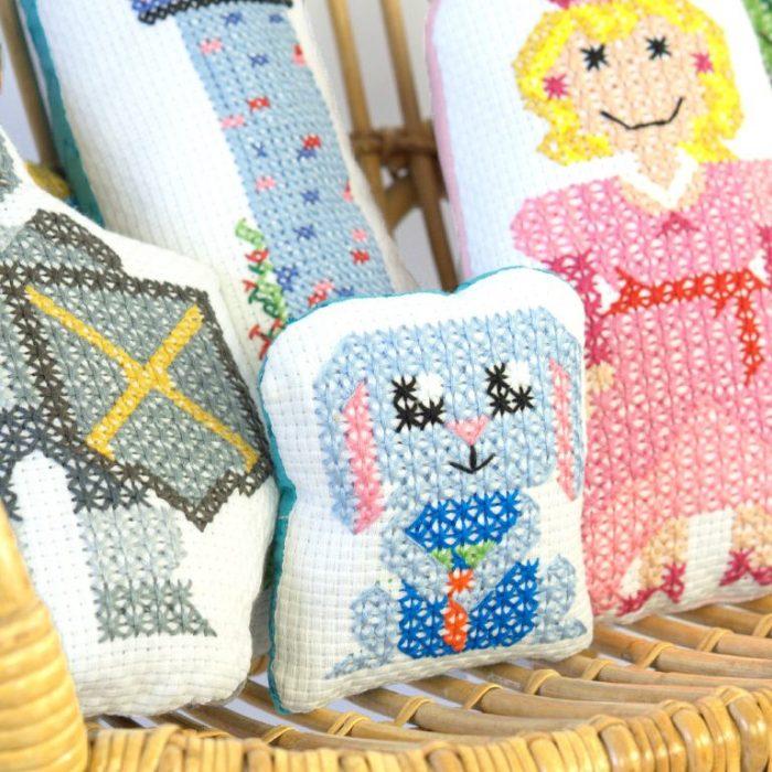 cross stitched dolls