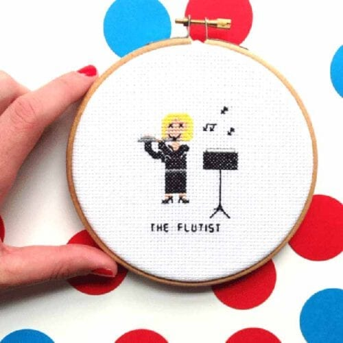flutist completed cross stitch design