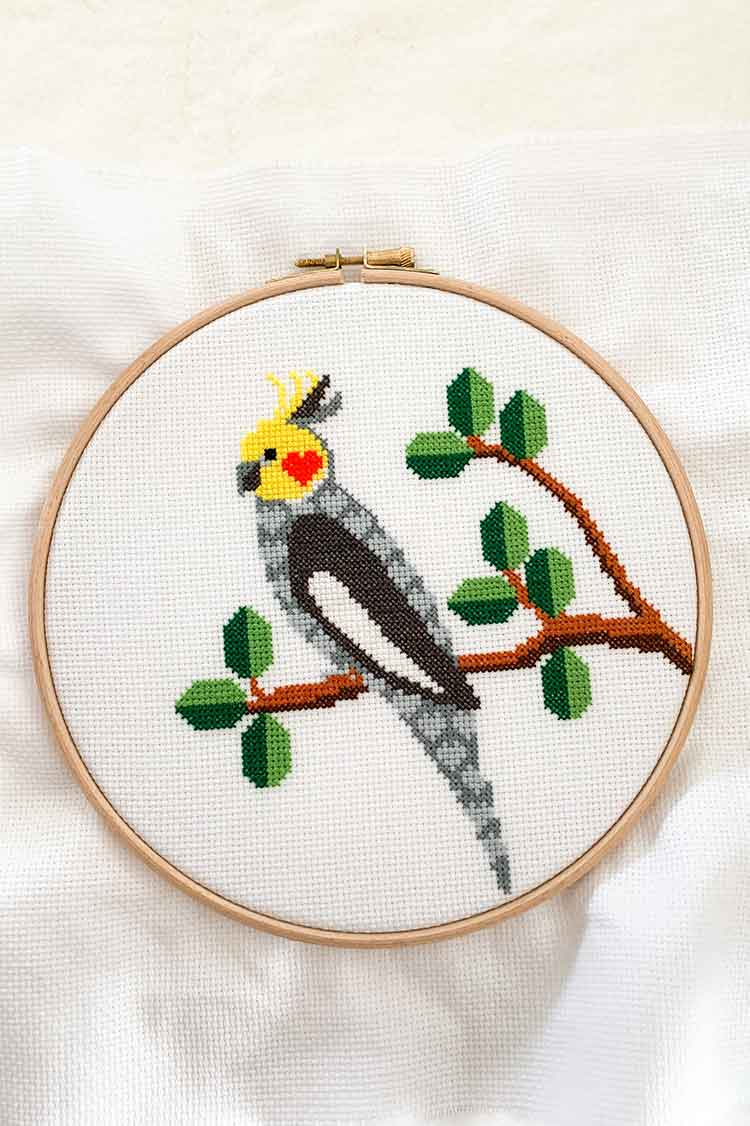 how to frame your cross stitch project in an embroidery hoop