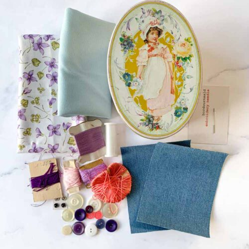 sale vintage girl sewing tin