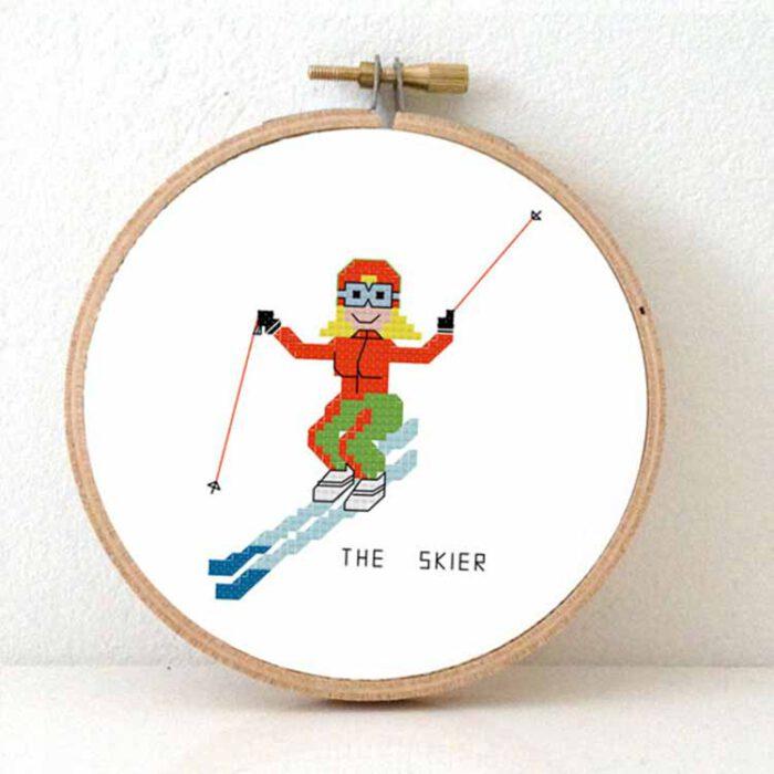 Female skier cross stitch pattern